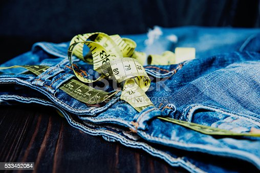 istock Jeans and measuring subject for weight loss 533452084
