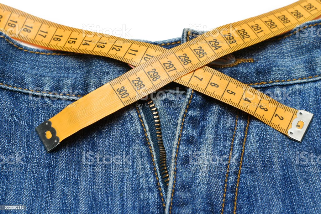 Jeans and tape measure stock photo