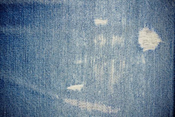 牛仔褲背景破舊牛仔花紋經典紋理藍色背景牛仔布帆布 - 牛仔褲 個照片及圖片檔