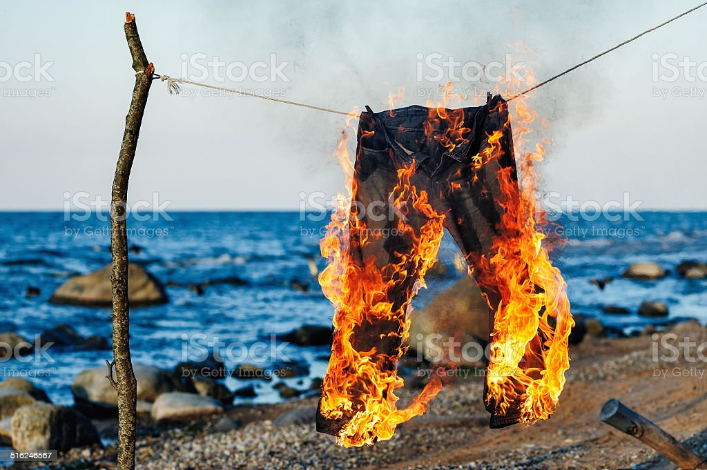 Jeans burning stock photo