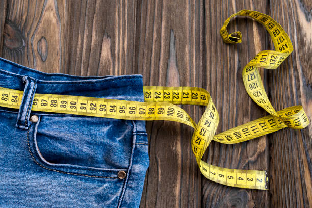 jeans, centimeter on a wooden background. stock photo