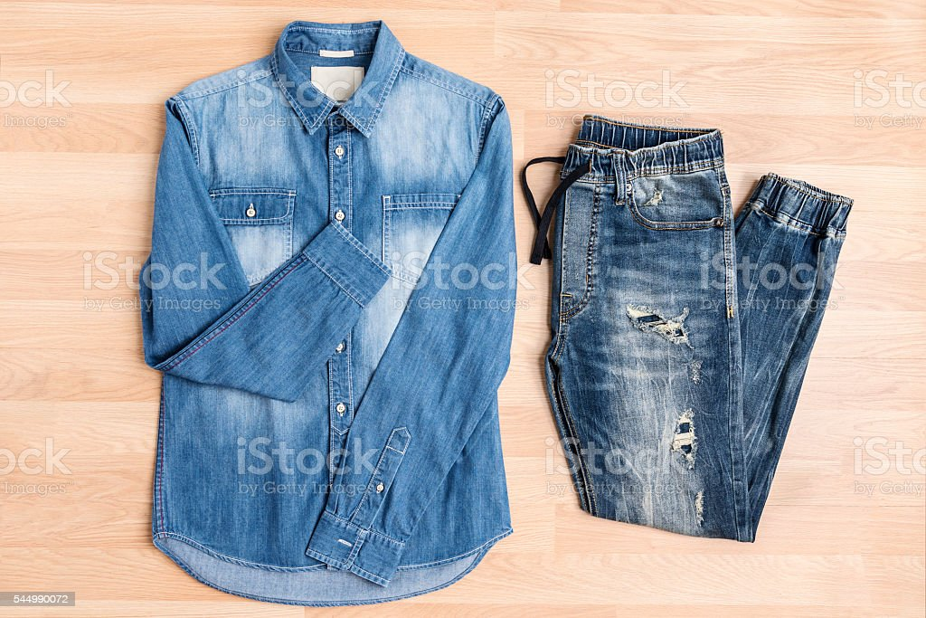 Jeans denim fashion casual clothing on wooden table, shirt and jog...