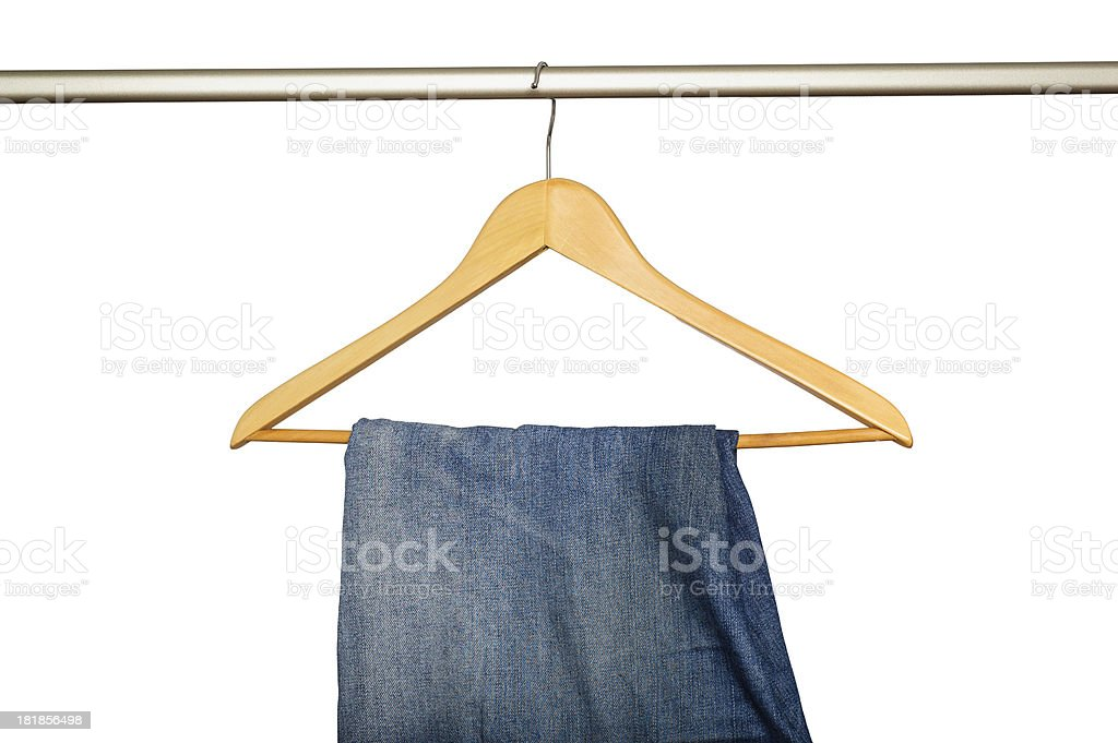 Jeans hanging on wooden hanger royalty-free stock photo