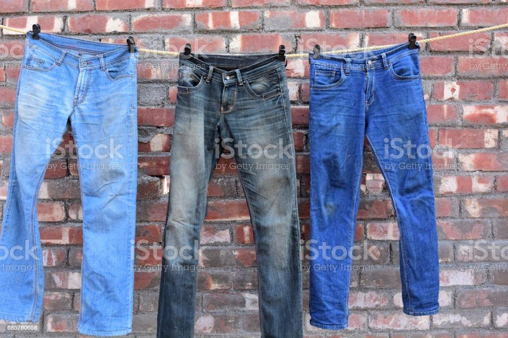 Jeans hanging royalty free stockfoto