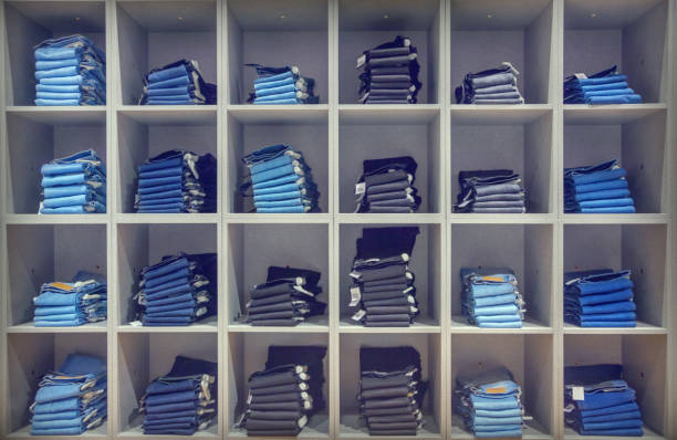 jeans in the fashion store - jeans stock photos and pictures