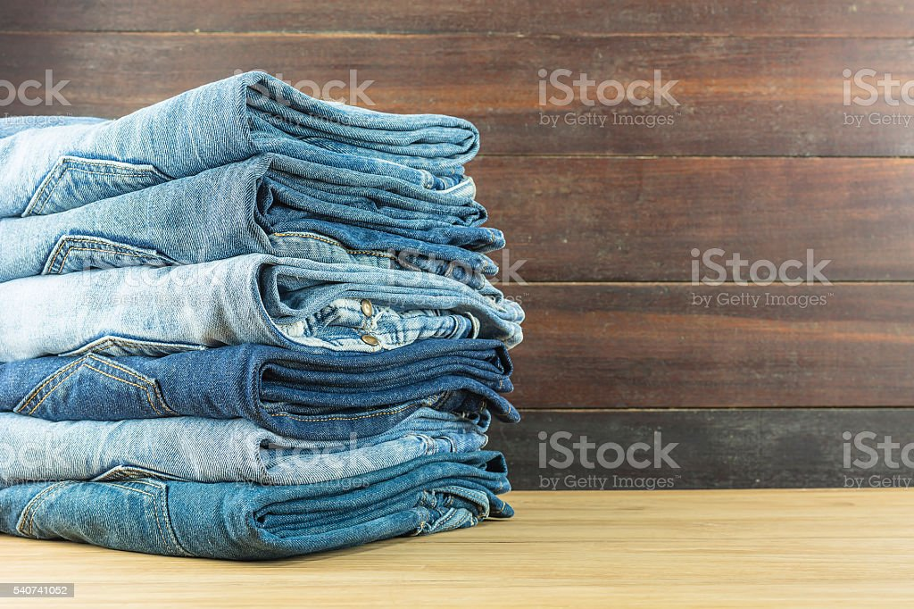 Jeans on a wooden background. stock photo