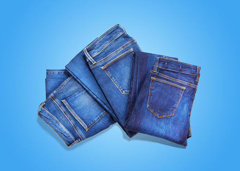 Jeans On Blue Background Stock Photo - Download Image Now