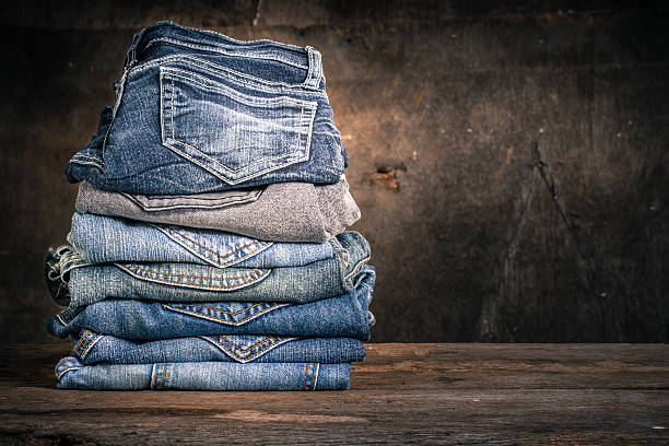jeans stack vintage - jeans stock photos and pictures