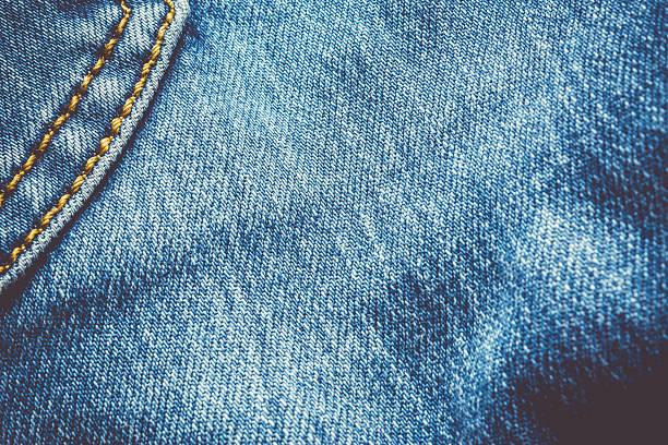 jeans texture - zwarte spijkerbroek stockfoto's en -beelden