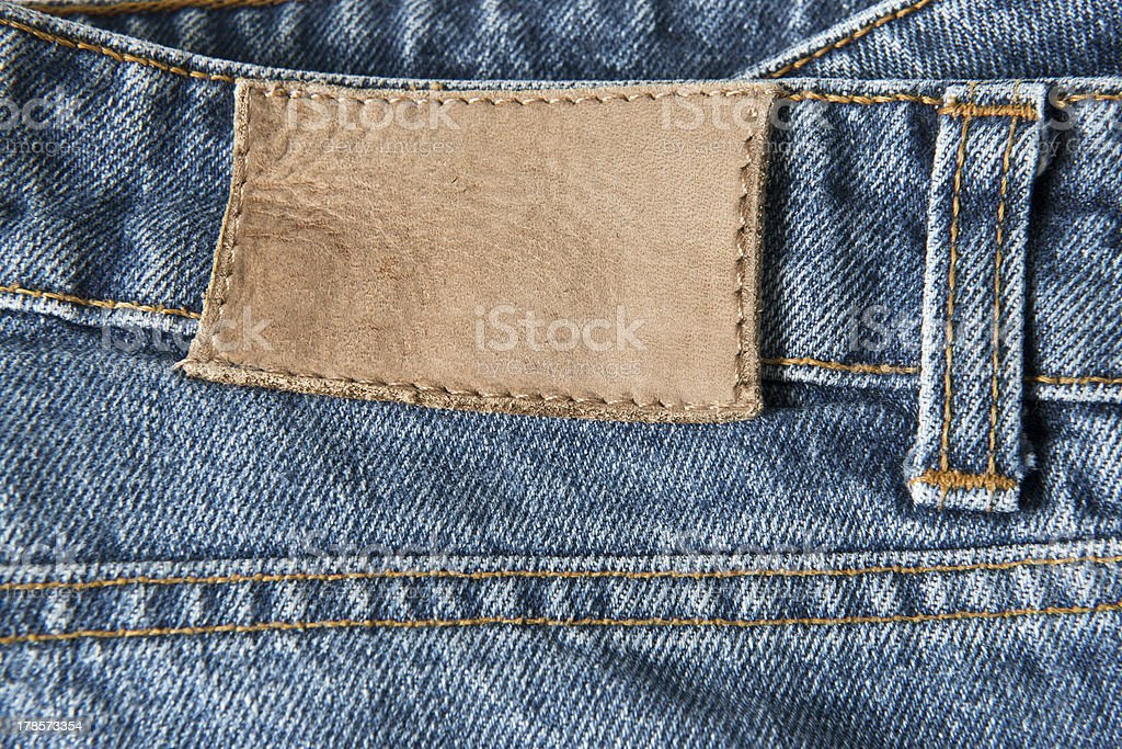 Jeans with empty leather label royalty-free stock photo