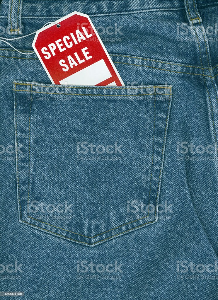 Jeans with special sale tag royalty-free stock photo