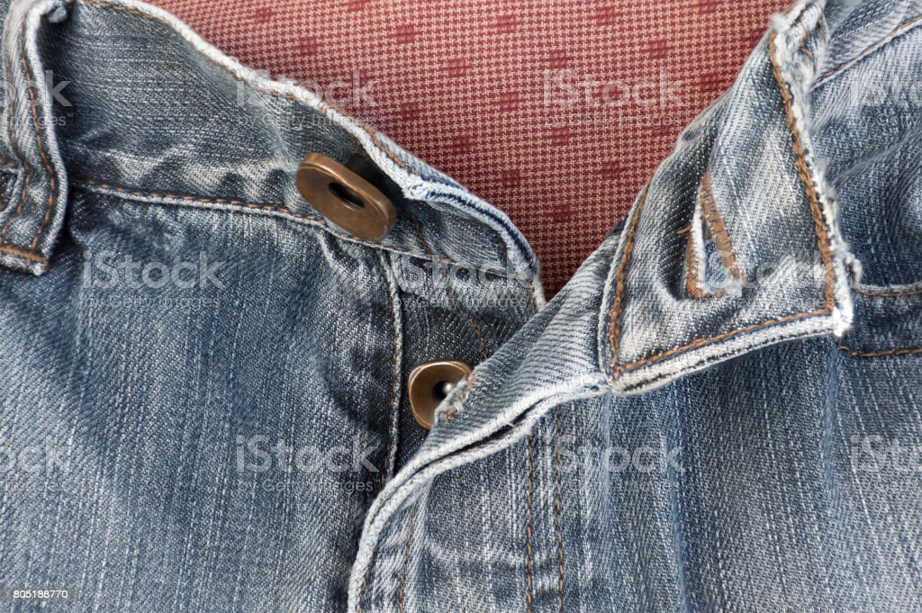 Jeans zipper instead of buttons to use. Takes longer to unbutton all. stock photo