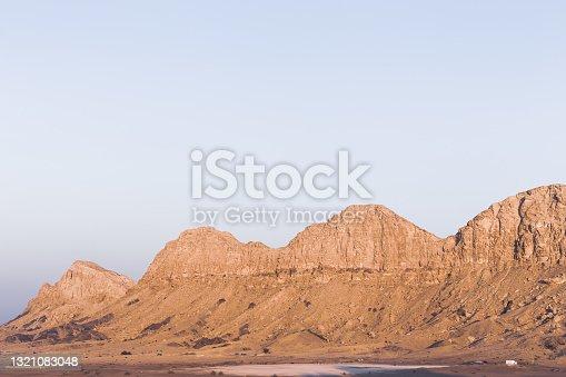 Jebel al Fayah (Al Faya) mountain range in Mleiha, Sharjah, United Arab Emirates, rocky and barren mountain ridge in the desert.