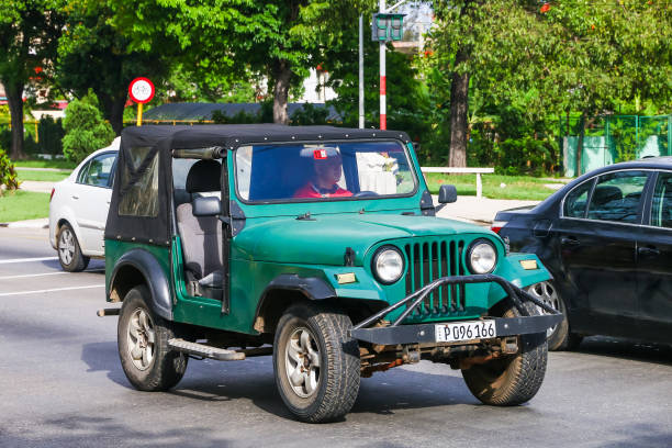 Jeep CJ Havana, Cuba - June 6, 2017: Motor car Jeep CJ in the city street. willys stock pictures, royalty-free photos & images
