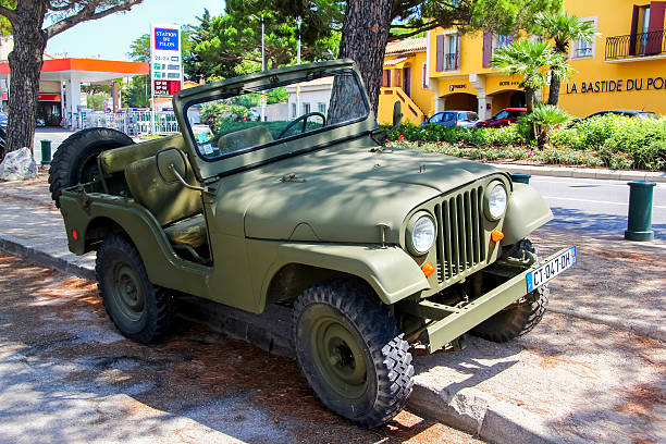 Jeep CJ-5 Saint-Tropez, France - August 3, 2014: Motor car Jeep CJ-5 is parked at the city street. willys stock pictures, royalty-free photos & images