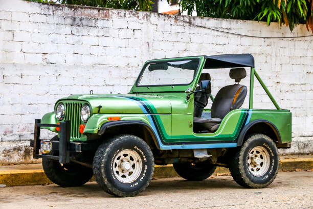 Jeep CJ-5 ACAPULCO, MEXICO - MAY 31, 2017: Motor car Jeep CJ-5 in the city street. willys stock pictures, royalty-free photos & images