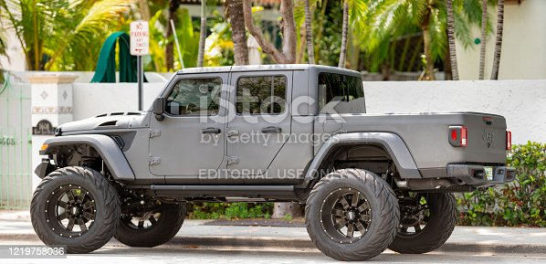 Fort Lauderdale, FL, USA - April 18, 2020: Jeep Gladiator 4x4 vehicle lifted with oversized wheels and off road tires