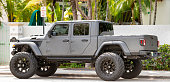 istock Jeep Gladiator 4x4 vehicle lifted with oversized wheels and off road tires 1219758036