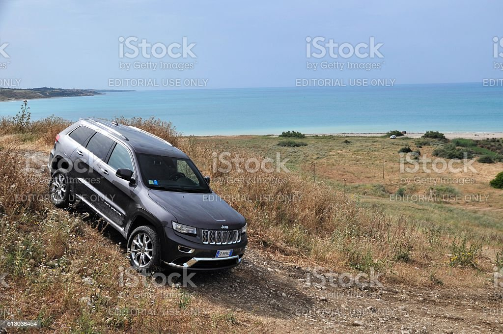 Jeep Grand Cherokee and a view of the sea stock photo