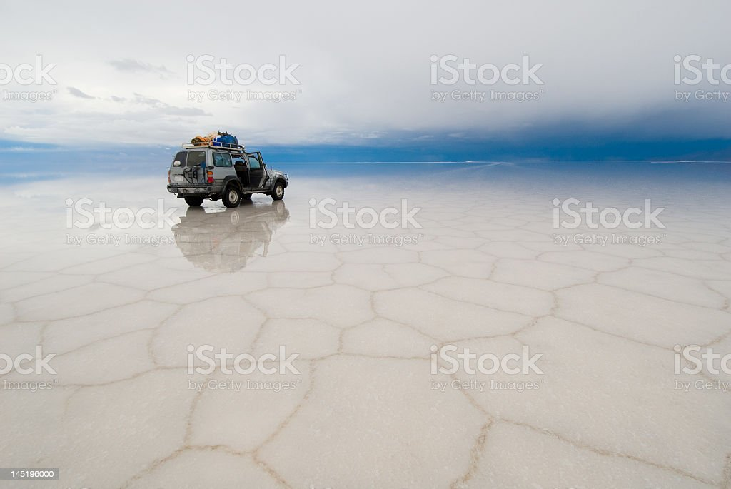Jeep in the salt lake of Salar de Uyuni, Bolivia stock photo