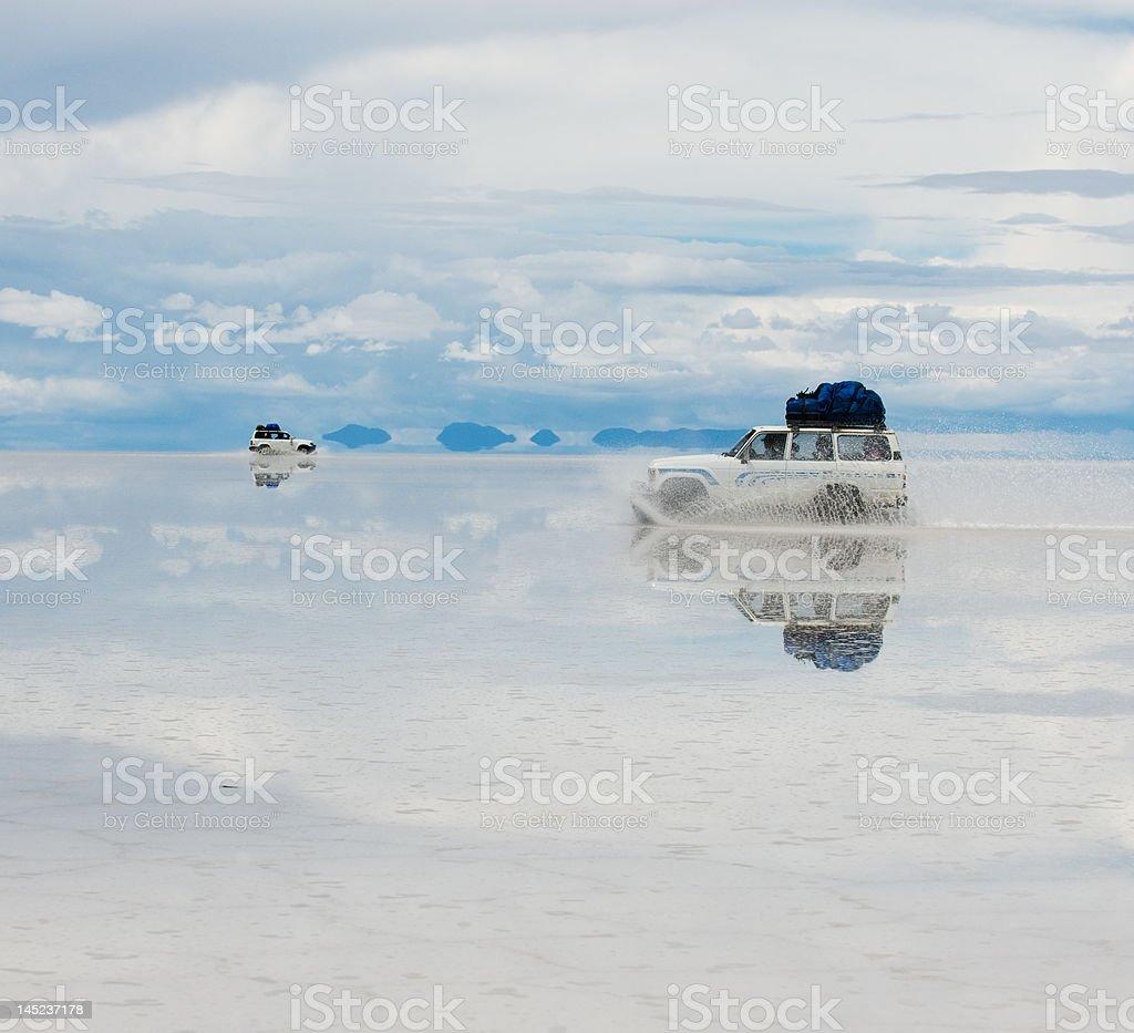 jeep in the salt lake salar de uyuni, bolivia royalty-free stock photo