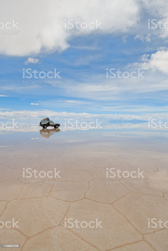 jeep in the salt lake salar de uyuni, bolivia royalty-free stock photo