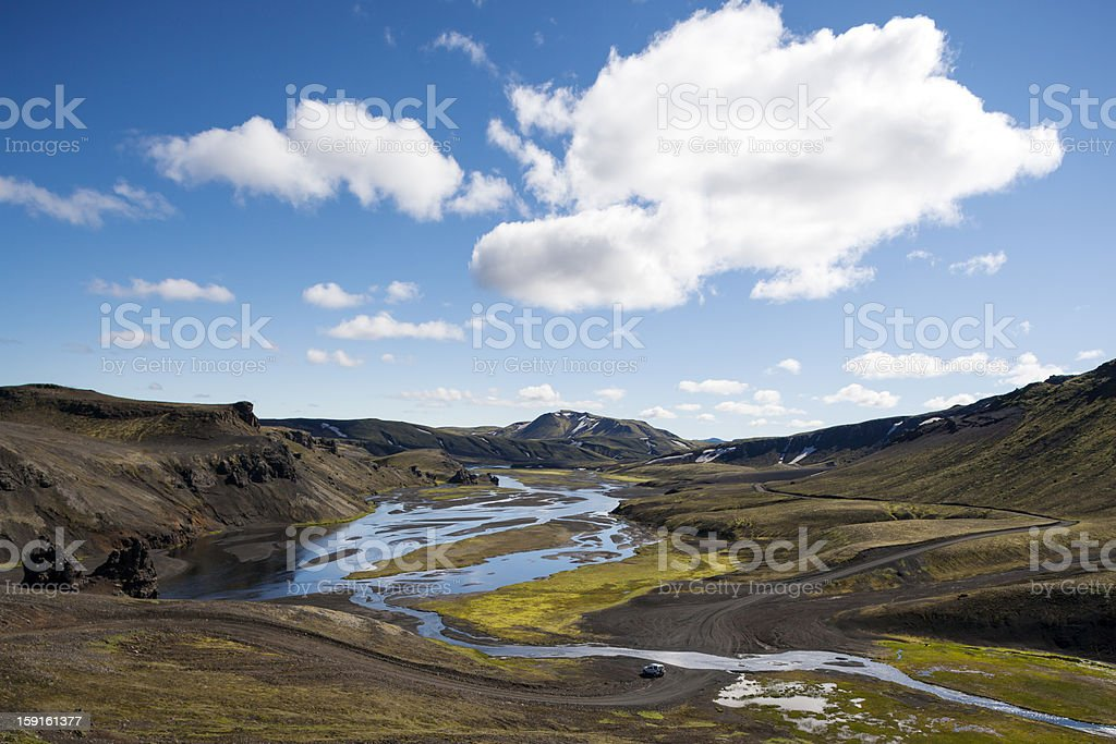 Jeep is driving in highlands of Iceland, royalty-free stock photo