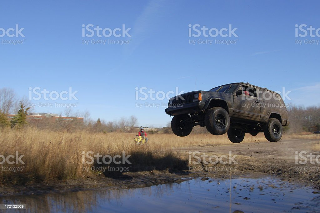 Jeep Jumping over a Puddle stock photo