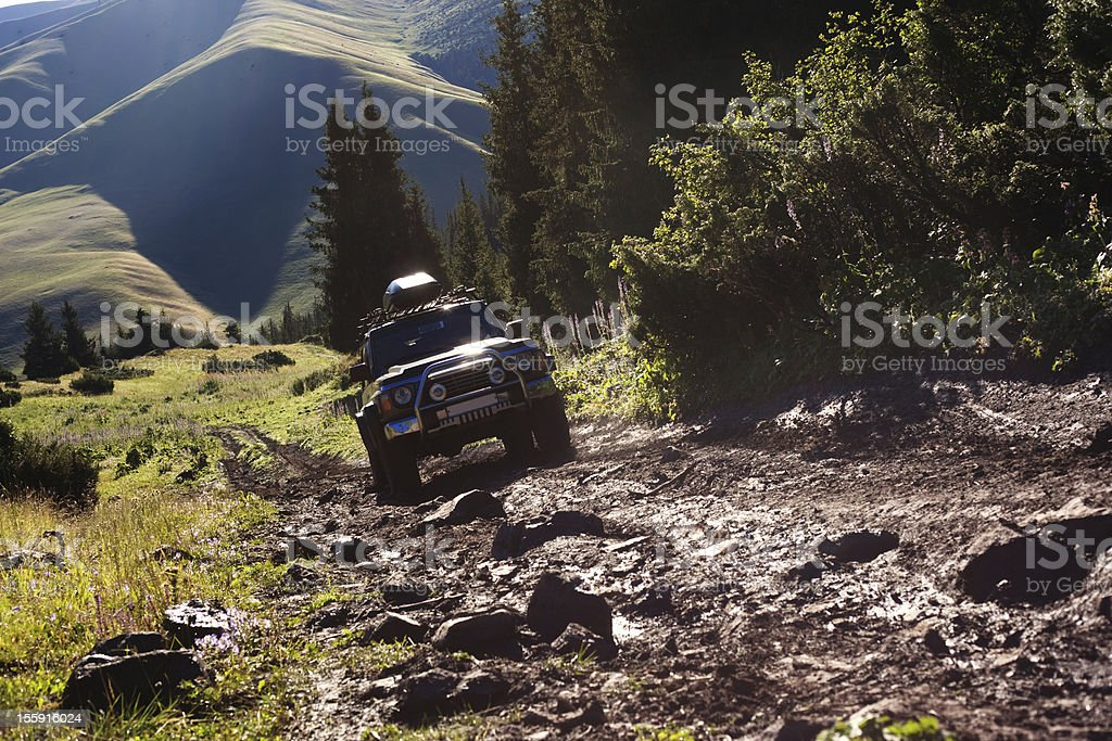 Jeep navigating rough terrain during an off-road drive stock photo