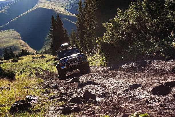 jeep navigating rough terrain during an off-road drive - extreme terrain stock photos and pictures