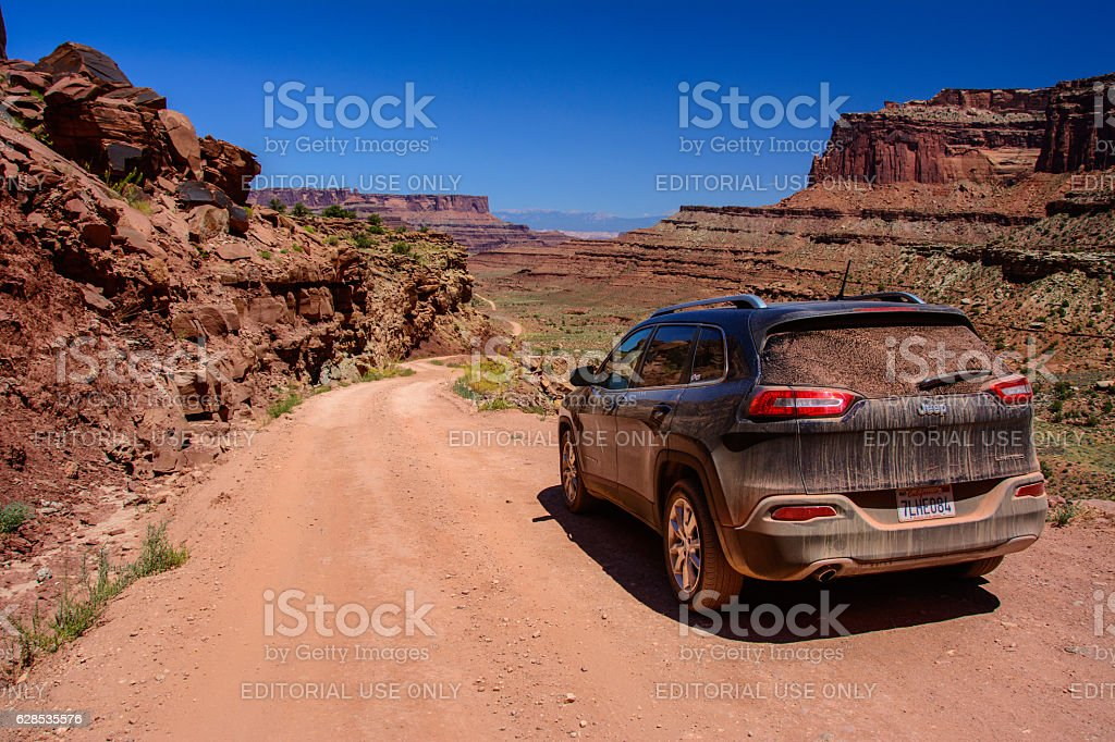 Jeep on the Shafer Trail road in Canyonlands National Park stock photo