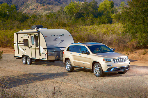 Jeep pulling a  sonic camper horizontal