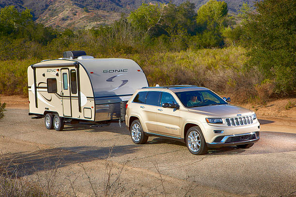 Jeep pulling a  sonic camper horizontal stock photo