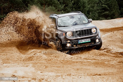 Siedlce Desert / Poland - 02 July 2017 : Fun in the desert with a 4x4 car. Jeep Renegade is doing great in the slushy sand.