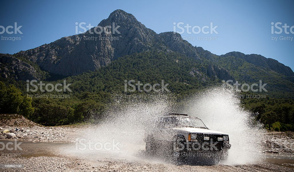 jeep, throwing the water stream passing through stock photo
