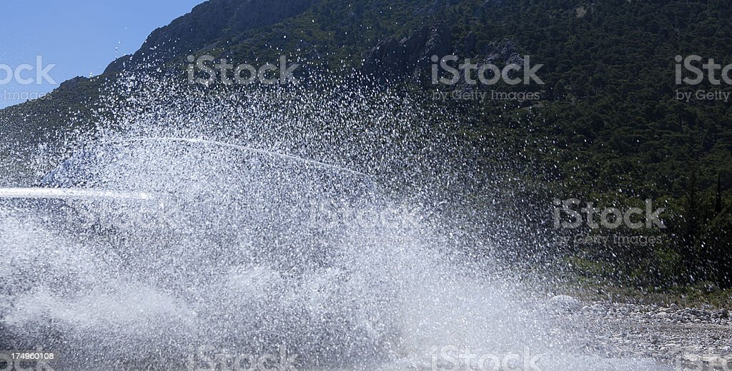 jeep, throwing the water stream passing through royalty-free stock photo