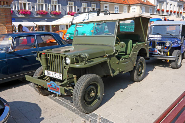 Jeep Willys CJ-2 1945 classic car SAMOBOR, CROATIA - JULY 17, 2011: Jeep Willys CJ-2 1945 classic car, ''14. Oldtimer Rally'' in Samobor, Croatia willys stock pictures, royalty-free photos & images