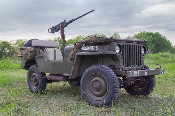 Jeep with a machine gun of the American army at a historical reconstruction in honor of the anniversary of victory in World War II Kiev, Ukraine - May 09, 2018: Jeep with a machine gun of the American army at a historical reconstruction in honor of the anniversary of victory in World War II willys stock pictures, royalty-free photos & images
