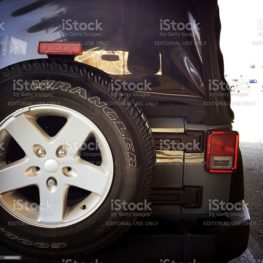 Jeep Wrangler and Goodyear Tire stock photo