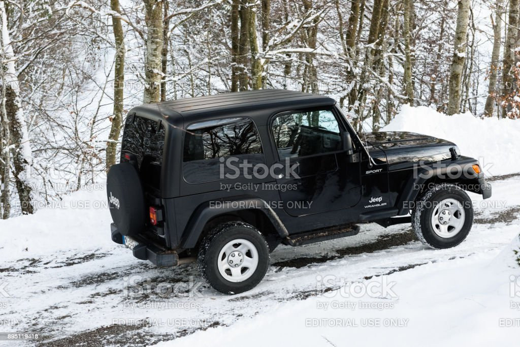 Jeep Wrangler on a snowy road
