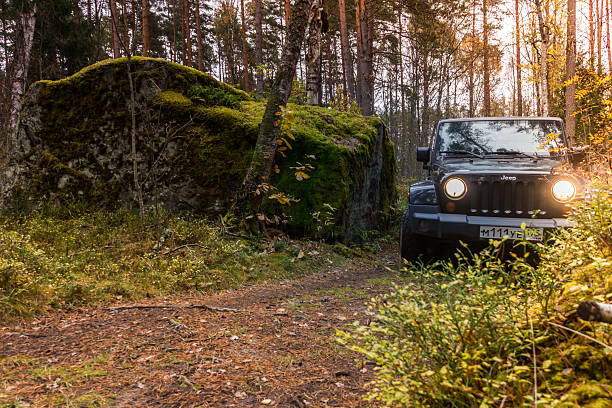 Jeep Wrangler Leningrad Oblast, Russia, 15 October 2014. Jeep Wrangler in the Karelian woods, the Jeep Wrangler is a compact four wheel drive off road and sport utility vehicle republic of karelia russia stock pictures, royalty-free photos & images