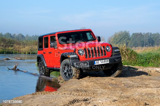 Seklak, Poland - 10 October, 2018: Jeep Wrangler Rubicon (JL) stopped on the riverside. This vehicle is used to get in extremely hard areas.