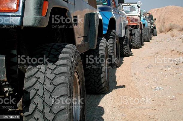 Photo of Jeeps in a row.