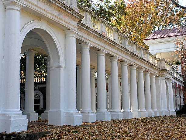 Jeffersons Rotunda - Columned Walkway Columned walkway that is part of Thomas Jeffersons Rotunda on the campus of the University of Virginia, Charolottesville,  United States of America. charlottesville stock pictures, royalty-free photos & images