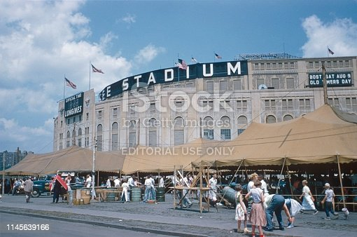 Bronx, New York City, NY, USA, 1958. In front of the old Yankee Stadium. Also: catering tents, helper, co-worker and visitors.