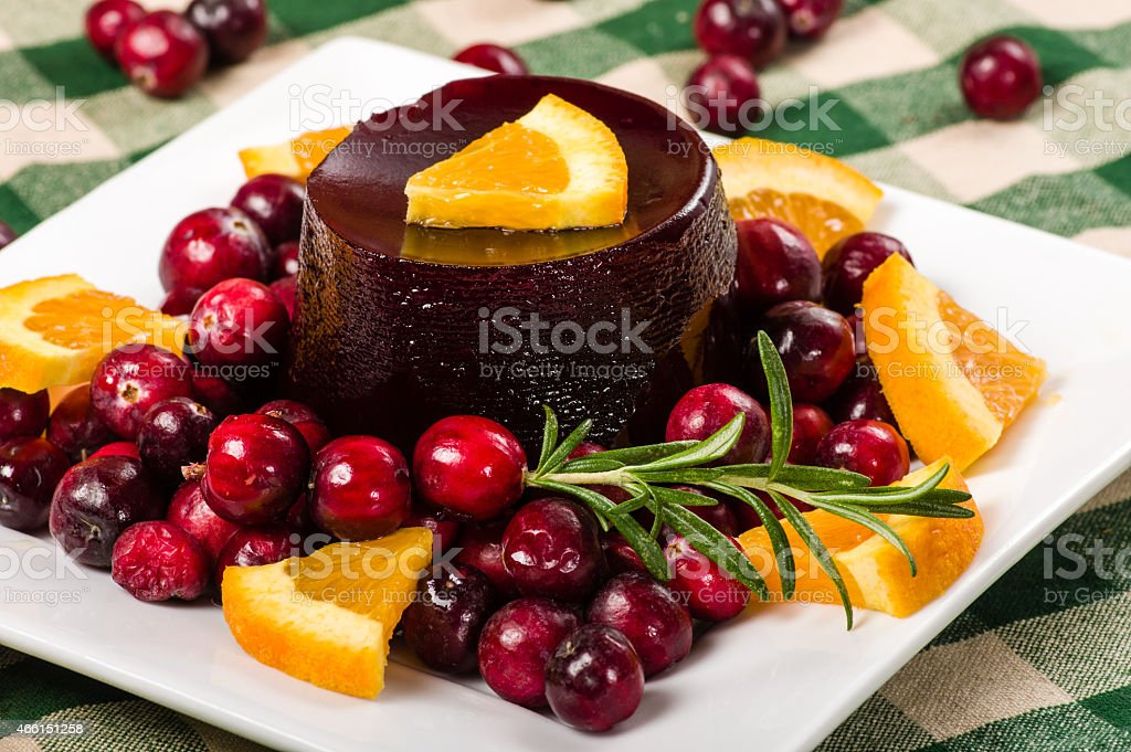 Jellied cranberry sauce with orange wedges stock photo