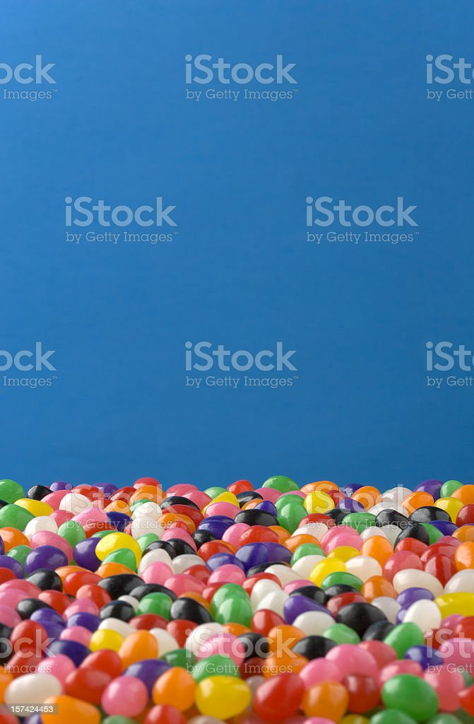 Jelly Beans against blue background, nice for Easter stock photo