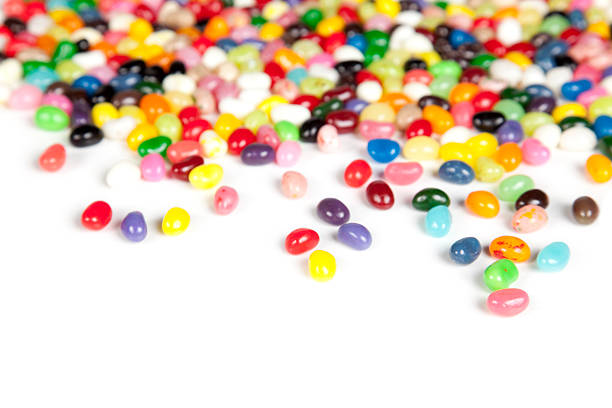 Jelly beans scattered on a white background stock photo