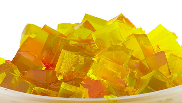 jelly cubes in bowl jelly cubes in bowl jello stock pictures, royalty-free photos & images