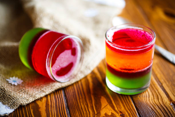 jelly fruit colored puff jelly fruit colored puff in a glass beaker gelatin stock pictures, royalty-free photos & images
